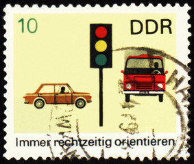 Post stamp with car, truck and light signal