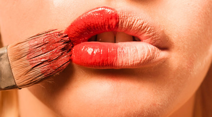 Conceptual photo of a makeup and the lips of a girl