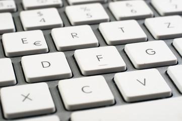 Closeup of a white clean keyboard