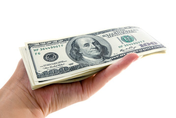 american hundred dollars bundle in the hand isolated on white ba