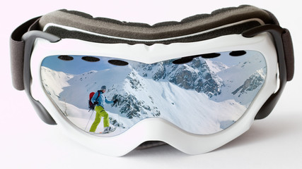 Reflection in goggles, female trekking in snow racket