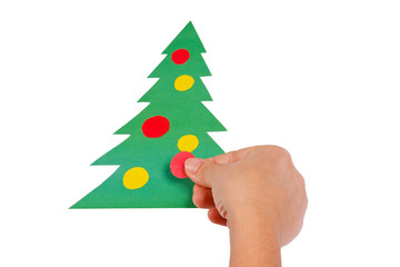 Creating Christmas tree of colored paper on a white background