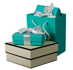 Gift boxes with white bow and gift bag on the white background