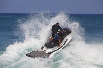Water jet hitting big waves