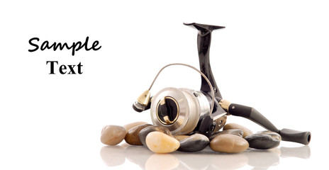 Fishing Reel on Rocks with Space for Text