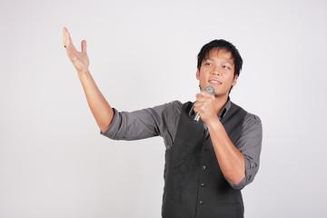 Filipino man singing and smiling