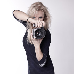 Beautiful photographer with her camera at a photo shoot