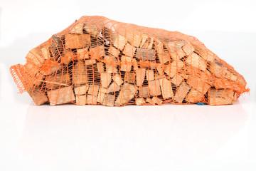 Anfeuerholz im Sack