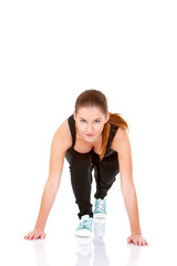 Cute fitness woman doing stretching exercise on white