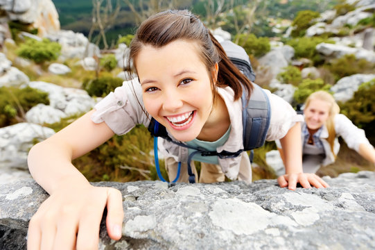 carefree outdoor climbing woman