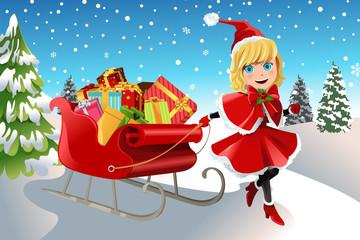 Christmas girl pulling sleigh