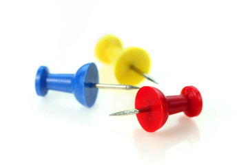 Three colorful push pins