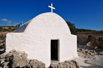 Charming little white church often seen in Greece