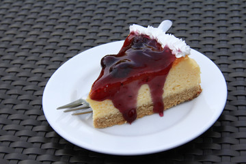 A piece of delicious blueberry cheesecake on a plate