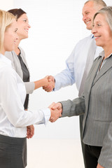 Business partners close deal people shaking hands