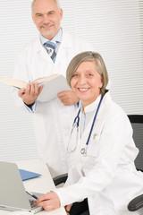 Medical team doctors by desk work computer
