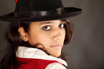Beautiful young  woman wearing a hat