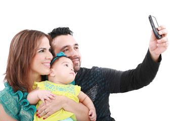 Closeup of happy family smiling over white background taking sel