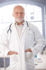 Mature doctor smiling in lab coat