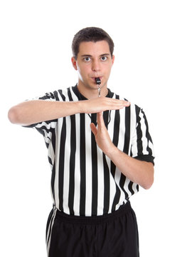Teen basketball referee giving sign for technical foul