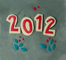 пластилиновые цифры  - 2012 год и листики