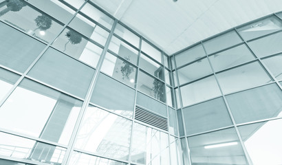 wide glass surface of contemporary angle of business building