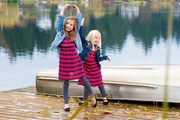 Kids outside on a lake