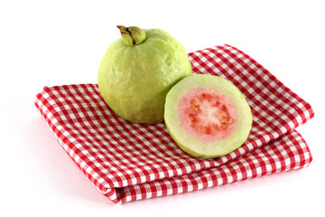 Fresh Pink Apple Guava on a Checkered table cloth