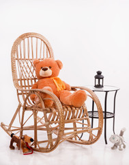 Old wooden rocking chair with toys