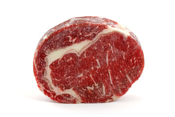 A frozen cut of outer side of the rib : prime rib eye steak
