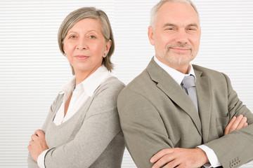 Senior businesspeople serious cross arms portrait