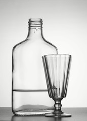 Alcoholism. Bottle with vodka and liquor-glass