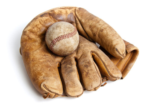Vintage baseball glove and ball isolated on white
