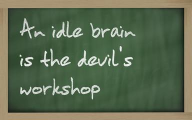""""""" An idle brain is the devil's workshop """" written on a blackboar"""