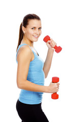 Smiling girl lifting barbells on a white background