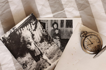 antique pocket watches and old photos