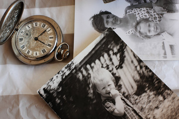 antique pocket watches and old photos. Focus on the clock