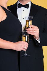Couple in evening dress holding Champagne