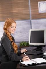 Happy businesswoman working
