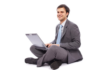 Young businessman typing on a laptop