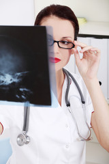 Female doctor looking at x-ray.