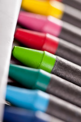 New crayons in a box with shallow dof