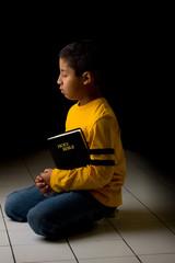 Child Praying with Bible