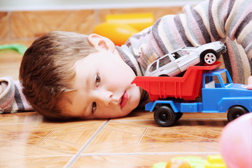 Little Boy Playing with Toy Car Close