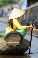 Woman on boat in Vietnam