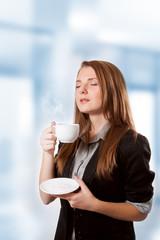 Businesswoman to inhale aroma coffee