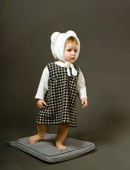 Sweet little baby dressed like bear
