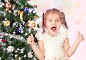 beautiful girl with a Christmas tree
