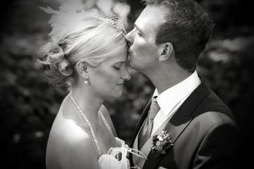 romantic wedding kiss on forehead