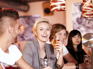 Friends in a pub enjoy nightlife